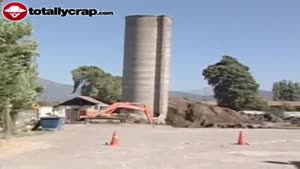 Concrete silo falls on digger