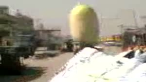 Iraqi woman carries huge melon on her head!