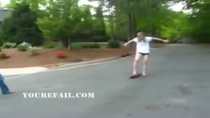 Girl fails at skating down hill
