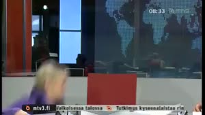 Finnish Newsreader falls off chair.