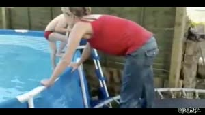Mother cracks back in pool jump