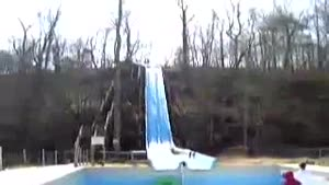 Kid Takes Waterslide Into Empty Pool