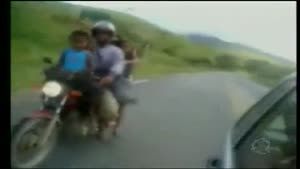 7 people on a motorcycle on highway in Brazil.