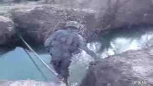Soldier Takes a Header On River Bank
