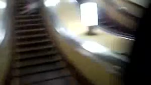 Kid Smashes Escalator Lamp With Head