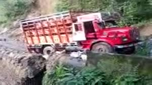 Indian Landslide Takes Down Truck