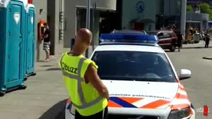 Dutch Guy Pisses On Police Car