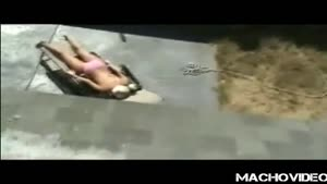 Tanning Girl Gets An Icecold Surprise