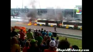 Car Drives Through Burning Buses