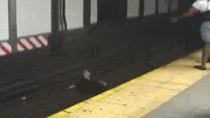 Girl Jumps On Tracks NYC Subway