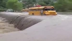 Buses Cross Flooded Bridge