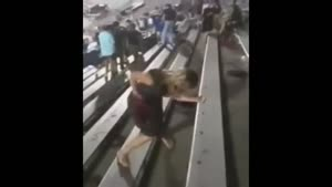 Drunk Girl Falls at Stadium