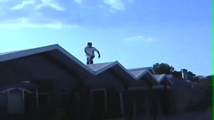 Skater Roof Jump Faceplant