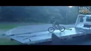 BMX Kid Faceplants Off Tow Truck