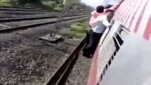 Guy Falls Off Overloaded Train