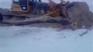 Bulldozer Falls Through Ice