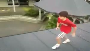 Kid Jumps From One Roof Through Another