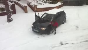 Woman Gets BMW Unstuck from Snow