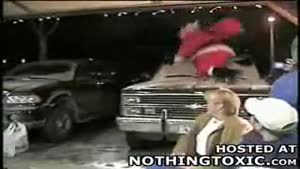 Drunk Santa Falls Off Roof