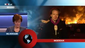 Massive Explosion Behind Dutch Reporter
