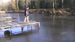 fat guy dives into frozen lake