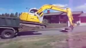 Unloading A Digger From A Truck