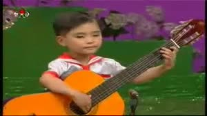 Chinese Toddlers Play On Big Guitars