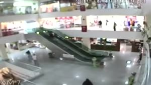 Man Saves Little Boy Falling Off Escalator