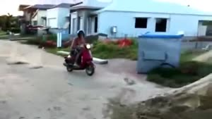 Moped Jump On Pile Of Sand