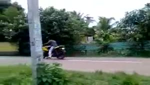 Wheelie Practicing Bike Rider Causes Accident
