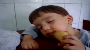 Tired Kid Tries To Eat His Ice Cream