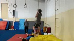 Climbing A Rope While Hula-Hooping