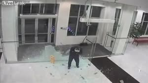 Man Walks Through Glass Entrance