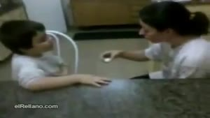 Mom Demonstrates Her Son How To Take His Medication