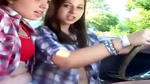 Teenage Girls Act Cool In Dad's Car