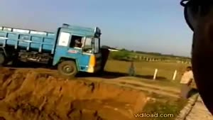 Truck Tumbles Over