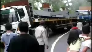 And Another Truck Tumbles Over