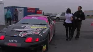Girl Almost Loses Her Top During Drift