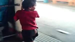 Parenting Fail - Kid Swinging Outside The Train