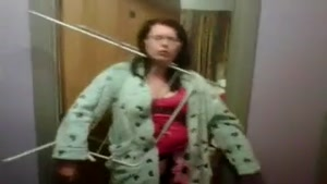 Woman Has Her Head Stuck Between The Clothes Horse