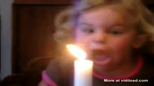 Little Girl Has Trouble Blowing Out The Candle