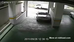 An Asian Woman, A Car And A Parking Garage