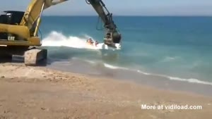 Excavator Fun On The Beach