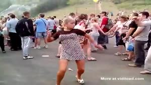 Girl Does Strange Dance At Festival