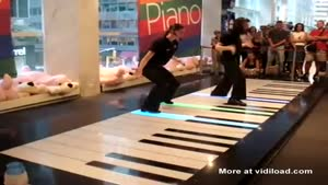 Girls Play Giant Piano