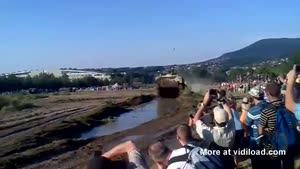 Unsuspecting Crowd Gets Muddy Surprise