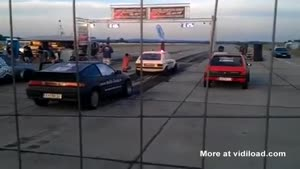 Drag Racer Reverses Into Another Car