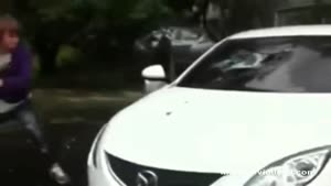 Dude Destroys Girlfriends Car With A Bat