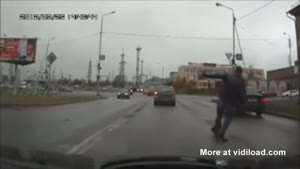 Dumb Guy Almost Gets Hit By Car