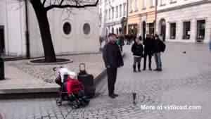 Toddler Helps Street Performer